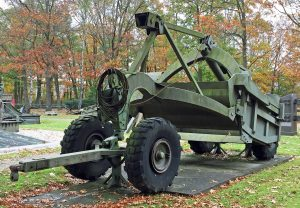 A towed scraper